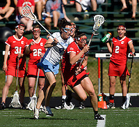 Jenn Russell (9) of North Carolina plays defense on Morgan Hale (34) of Cornell at St. Stephens and St. Agnes High School in Alexandria, VA.  North Carolina defeated Cornell, 13-7.