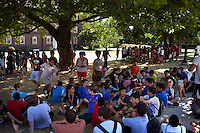 Students rest in the shade while waiting to head to their afternoon activities after classes had finished during Center for Talented Youth summer program at Lafayette College in Easton, PA on July 06, 2012. Several students were part of the Rural Connections scholarship program being offered for the first time this year.