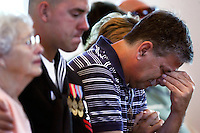 PUNTA GORDA, FL -- March 13, 2008 -- Kevin Hall cries with his family as he mourns the loss of his son during a memorial service for former Marine Eric Hall at the Faith Lutheran Church in Punta Gorda, Fla., on Thursday, March 13, 2008.  Hall went missing on Feb. 3 after having a flashback to his time in Iraq, and was found dead weeks later by the Vietnam veteran volunteers in a culvert.
