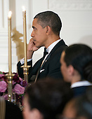United States President Barack Obama listens to U.S. Secretary of Defense Leon Panetta's remarks as he and first lady Michelle Obama host a dinner to honor our Armed Forces who served in Operation Iraqi Freedom and Operation New Dawn and to honor their families in the East Room of the White House in Washington, D.C. on Wednesday, February 29, 2012..Credit: Ron Sachs / Pool via CNP