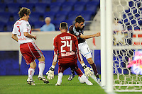 Colin Clark (11) of the Colorado Rapids almost scores on goalkeeper Greg Sutton (24) of the New York Red Bulls. The New York Red Bulls defeated the Colorado Rapids 3-0 during a U. S. Open qualifier match at Red Bull Arena in Harrison, NJ, on May 26, 2010.