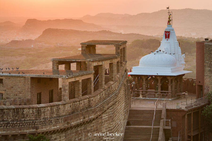 Sun setting over the Chamunda Devi temple, Mehrangarh Fort. Jodhpur, Rajasthan, India