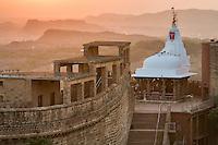 Sun setting over the Chamunda Devi temple, Mehrangarh Fort. Jodhpur, Rajasthan, India