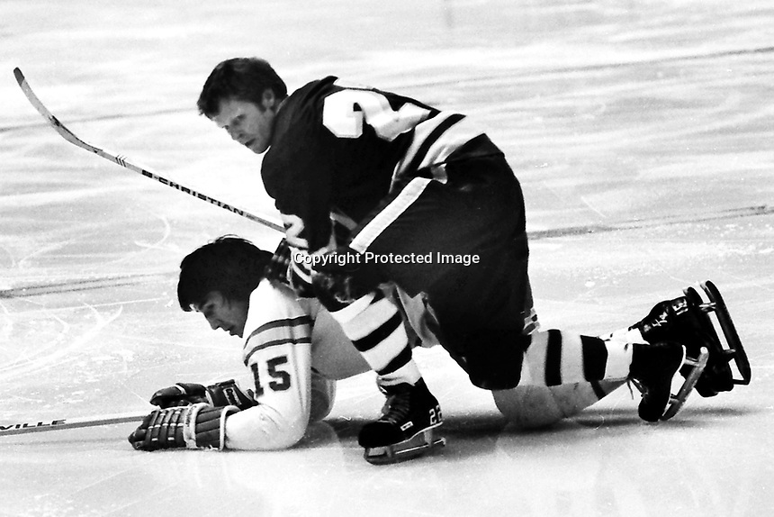 Minnesota North Stars Dennis Hextall atop Seals Jim Neilson (1972 NHL hockey action) Photo by Ron Riesterer.