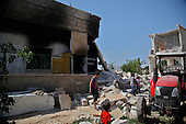 HOZANO, SYRIA: Children walk through the rubble of a destroyed home that was hit by tank rounds...A violent struggle between the Free Syrian Army and the Assad regime has been going on for over a year...Photo by Rachel Beth Anderson/Metrography