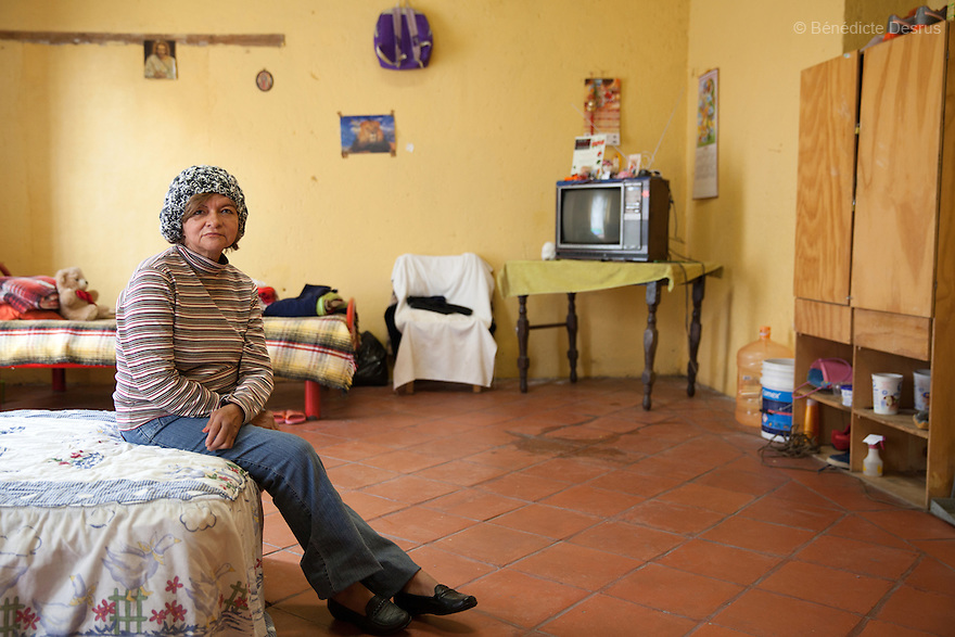 Portrait of Marta, resident of Casa Xochiquetzal, at the shelter in Mexico City, Mexico on July 8, 2013. Casa Xochiquetzal is a shelter for elderly sex workers in Mexico City. It gives the women refuge, food, health services, a space to learn about their human rights and courses to help them rediscover their self-confidence and deal with traumatic aspects of their lives. Casa Xochiquetzal provides a space to age with dignity for a group of vulnerable women who are often invisible to society at large. It is the only such shelter existing in Latin America. Photo by Bénédicte Desrus