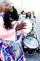 "The ""wild man"" of the Golden Comanches Mardi Gras Indians sings a song as he awaits his ""chief"" to present himself in New Orleans on February 28, 2006."