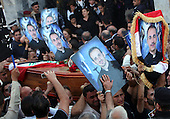 BAGHDAD, IRAQ: Iraqis carry coffins of the victims who died during the siege of the Our Lady of Salvation Catholic Church in Baghdad...At least 52 people were killed when Iraqi troops raided the Our Lady of Salvation Catholic Church where gunmen were holding hostages on Sunday...Photo by Ceerwan Aziz/Metrography