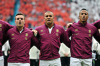 George Ford, Jonathan Joseph and Anthony Watson of England sing the national anthem. QBE International match between England and Ireland on September 5, 2015 at Twickenham Stadium in London, England. Photo by: Patrick Khachfe / Onside Images