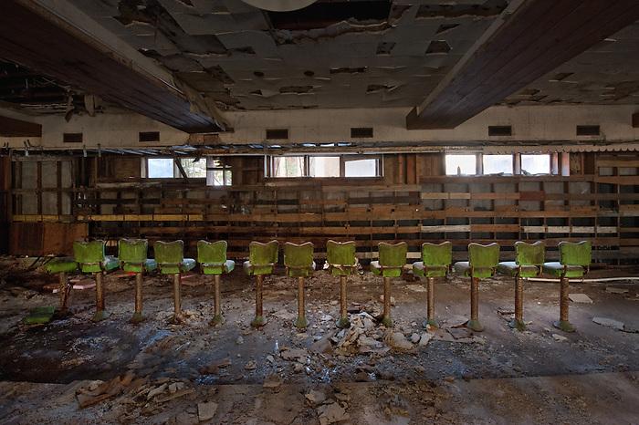 Bar Stools at an Abandoned Hotel