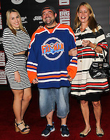 HOLLYWOOD, LOS ANGELES, CA, USA - NOVEMBER 04: Harley Quinn Smith, Kevin Smith, Jennifer Schwalbach Smith arrive at the Los Angeles Premiere Of Disney's 'Big Hero 6' held at the El Capitan Theatre on November 4, 2014 in Hollywood, Los Angeles, California, United States. (Photo by Celebrity Monitor)
