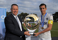 NZ Football chairman Deryck Shaw and Auckland captain Angel Berlanga with the trophy after the Oceania Football Championship final (second leg) football match between Team Wellington and Auckland City FC at David Farrington Park in Wellington, New Zealand on Sunday, 7 May 2017. Photo: Dave Lintott / lintottphoto.co.nz