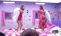 ASHLEIGH AND BECKY PILLOW FIGHTING DURING THE 'SLUMBER PARTY' TASK.in Big Brother, Day 50.full length bed pillows pillow fight pink bathrobe .*Filmstill - Editorial Use Only*.CAP/NFS.Supplied by Capital Pictures.