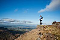 Female hiker on summit of Fan Y Big, Brecon Beacons national park, Wales