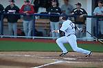 Ole Miss' Tanner Mathis (12) hits a double vs. Arkansas State in baseball action at Oxford-University Stadium in Oxford, Miss. on Tuesday, February 21, 2012. Ole Miss won the home opener 8-1 to improve to 2-1 on the season. Arkansas State dropped to 0-3.