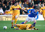 Motherwell v St Johnstone...28.01.12  .Keith Lasley takes out Murray Davidson.Picture by Graeme Hart..Copyright Perthshire Picture Agency.Tel: 01738 623350  Mobile: 07990 594431