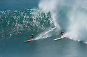 Makua Rothman (HAW) and Unknown surfer during the Quiksilver Eddie Aikau at Waimea Bay on the Northshore of Oahu in Hawaii