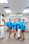 Members of the Sun City Aqua Suns, a synchronized swim team made up of retirees, pose in a locker room at the Lakeview Recreation Center before a performance at the Holiday Around the World celebration in Sun City, Arizona December 10, 2010...2010 marks the 50th anniversary of Sun City, America's first retirement city that remains the largest today with more than 40,000 residents 55 and older.