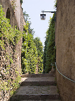 Narrow street with steps in Ravello, Amalfi Coast, Italy,   Lamp over street.