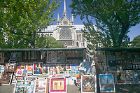 Book stalls of Les Bouquinistes on Quai de Montebello on the left bank of the Seine River with Notre Dame in the background