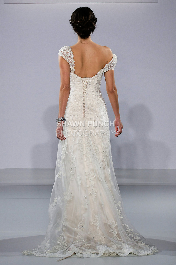 Model walks runway in an Emma wedding dress from the Maggie Sottero Spring 2013 collection, at The Couture Show, during New York Bridal Fashion Week, on October 14, 2012.