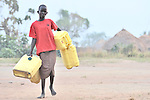 A girl in Yei, Southern Sudan, walks to a well to get water.