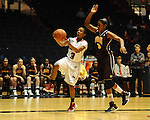 "Ole Miss' Valencia McFarland (3) vs. Central Michigan's Jessica Green (3) at C.M. ""Tad"" Smith Coliseum in Oxford, Miss. on Wednesday, December 14, 2011."