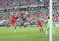 27 August 2011: San Jose Earthquakes forward Chris Wondolowski #8 heads the ball toward the Toronto FC goal during a game between the San Jose Earthquakes and Toronto FC at BMO Field in Toronto..The game ended in a 1-1 draw.