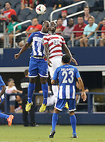 Eddie Johnson #26 of the USMNT battles with Osman Chavez #2 of Honduras on July 24, 2013 at Dallas Cowboys Stadium in Arlington, TX. USMNT won 3-1.