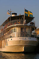 Historic boat with Swedish flag.