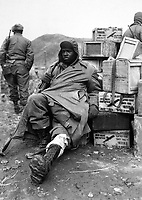 Pfc. Edward Wilson, 24th Inf. Regt., wounded in leg while engaged in action against the enemy forces near the front lines in Korea, waits to be evacuated to aid station behind the lines.  February 16, 1951. Pfc. Charles Fabiszak. (Army)<br /> NARA FILE #:  111-SC-358355<br /> WAR &amp; CONFLICT #:  1394