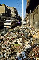 Rubbish dumped in city street. Alexandria. Egypt.