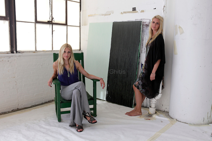 Jaime, 29, and Daisy Johnson, 24, pose for a portrait at the artist Pat Steir's studio in Chelsea on Thursday, Sept. 8, 2011. The sisters, who are emerging photographers, are developing a photo essay about Steir...Danny Ghitis for The New York Times