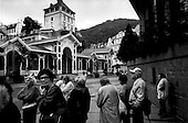 Karlovy Vary, Czech Republic.July 1997.This well known city is booming. Its? famous spring waters bring in both tourists and the sick for rejuvenation. Although the visitors, many Russian, give this city a bizarre atmosphere the city's beauty has been restored..