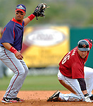10 March 2006: Royce Clayton, infielder for the Washington Nationals (left), attempts a tag on Jason Lane (right) during a Spring Training game against the Houston Astros. The Astros defeated the Nationals 8-6 at Osceola County Stadium, in Kissimmee, Florida...Mandatory Photo Credit: Ed Wolfstein..