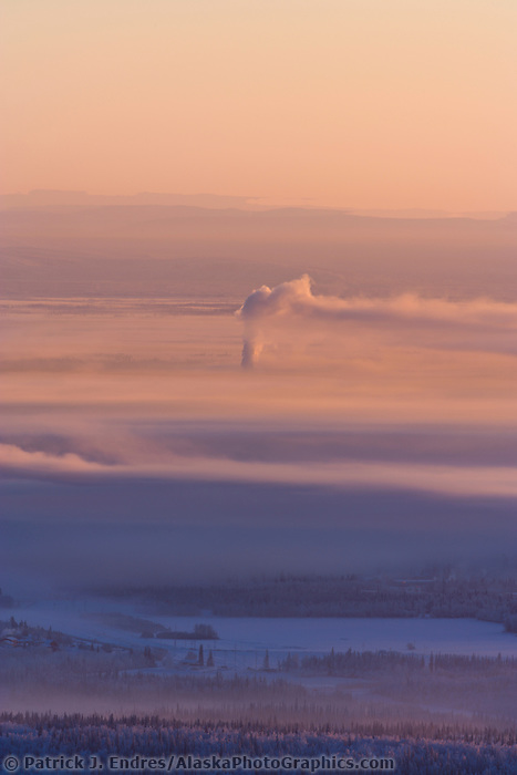 Sunrise and Ice Fog over the Tanana Valley Flats near Fairbanks during a minus 40 degree fahrenheit day. The Alaska Mountain Range looms in the distance