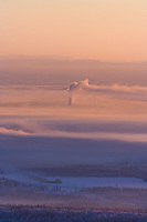Sunrise and Ice Fog over the Tanana Valley Flats near Fairbanks during a minus 40 degree fahrenheight day. The Alaska Mountain Range looms in the distance