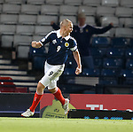 Kenny Miller runs up the park to celebrate