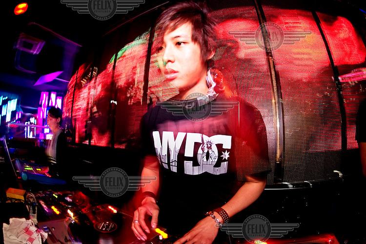 A DJ stands at his decks at Vics nightclub.