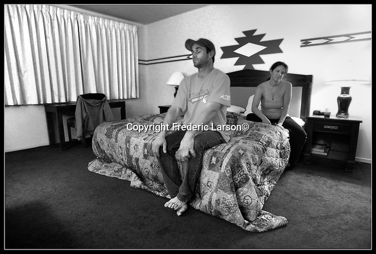 Tena Royal and David Martinson sit exhausted on their bedside at the Rio Sands Lodge from sleeping the night before under a bridge come to find themselves now homeless after being evicted from their studio apartment in Rio Vista., Calif., on April 22, 2009.