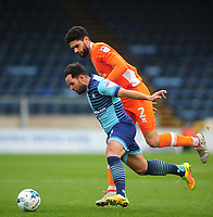 Wycombe Wanderers' Sam Wood under pressure from Blackpool's Kelvin Mellor<br /> <br /> Photographer Kevin Barnes/CameraSport<br /> <br /> The EFL Sky Bet League Two - Wycombe Wanderers v Blackpool - Saturday 11th March 2017 - Adams Park - Wycombe<br /> <br /> World Copyright &copy; 2017 CameraSport. All rights reserved. 43 Linden Ave. Countesthorpe. Leicester. England. LE8 5PG - Tel: +44 (0) 116 277 4147 - admin@camerasport.com - www.camerasport.com