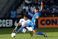 Diego Chavarria, (8) El Salvador lunges at the ball as Mario Martinez (7) Honduras is late in his challenge... Honduras defeated El Salvador 3-2 after extra time to go through to the final at LIVESTRONG Sporting Park, Kansas City, Kansas.