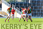 East Kerry Dara Moynihan tries to break away from the  Mid Kerry Defence during the County Minor Championship final in Fitzgerald Stadium on Sunday