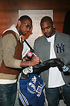 Fabolous and New York Giants Ahmad Bradshaw Sign a jacket to present to New York Cares at A Fabolous Way Foundation's 1st Annual 3 Kings Coat Drive wraps-up Press Conference and Autograph Signing In Conjunction With Dr. Jays, NY Cares, and Hot 97 Held at Dr. Jays 34th Street Store, NY 12/1/11