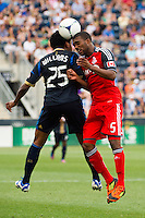 Sheanon Williams (25) of the Philadelphia Union goes up for a header with  Ashtone Morgan (5) of Toronto FC. The Philadelphia Union defeated Toronto FC 3-0 during a Major League Soccer (MLS) match at PPL Park in Chester, PA, on July 8, 2012.