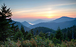 Idaho, North, Coeur d'Alene, Bayview. Summer sunset from high in the Coeur d'Alene Mountains of the Kaniksu National Forest with a small view of the southern end of Lake Pend Oreille.