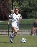Boston College midfielder Rosie DiMartino (19) brings the ball forward. Virginia Tech (maroon) defeated Boston College (white), 1-0, at Newton Soccer Field, on September 22, 2013.