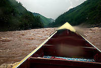 Northern Laos, August 17, 2007.Going down the Nam On river, swollen by monsoon rains in a speed boat is the fastest if dangerous way to travel in remote mountain areas. A powerful toyota engine propels this 5m long skiff at 60km/hour in the whitewater rapids...