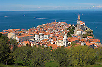 View over the roof tops with sea in the distance. Piran , Slovenia