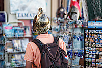 A tourist with helmet in the streets of Athens, Greece